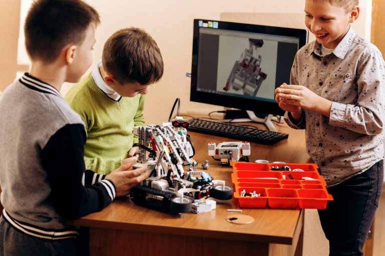 Three smart boys are making robots from the robotic constructor in British International Schools